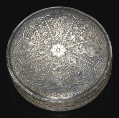 A fine small circular silver box and cover, Tang dynasty (618-907)