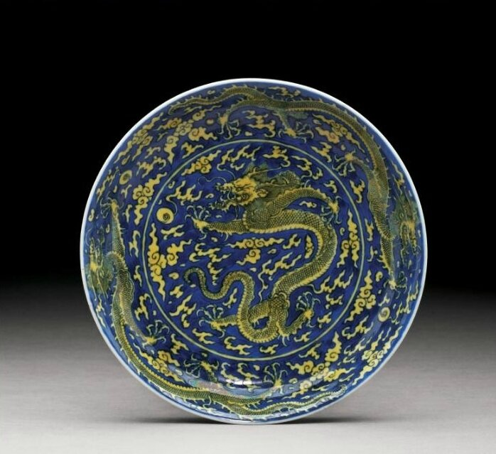 A yellow-enamelled and blue ground 'Dragon' dish, Kangxi mark and period (1662-1722)