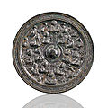 A bronze mirror with Daoist immortals and mythical animals, China, later Eastern Han dynasty (25-220 AD)