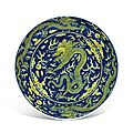 A blue-ground yellow-enamelled 'dragon' dish, qianlong six-character seal mark in underglaze blue and of the period (1736-1795)