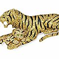 A colored diamond, diamond, emerald and enamel tiger and cub brooch, by van cleef & arpels.