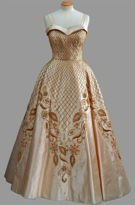 Norman Hartnell, Cream silk gown with straps and full skirt with lattice and foliate beaded embroidery