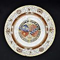A rouge-de-fer decorated armorial dish, 18th century