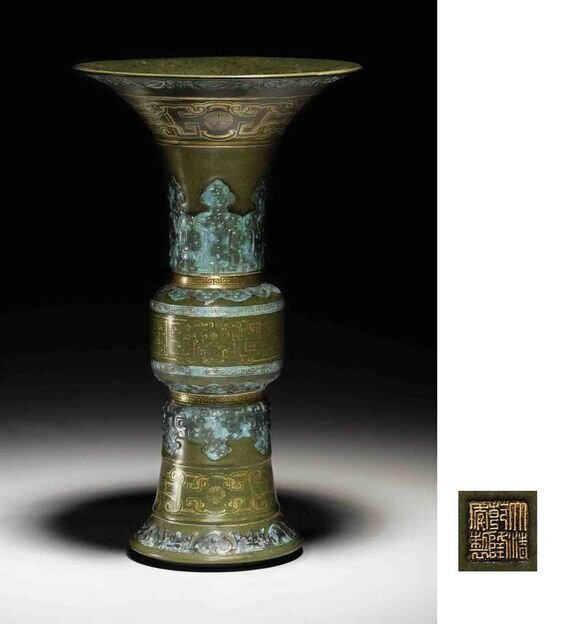 A rare gilt-decorated teadust-glazed imitation bronze beaker vase, gu, Qianlong incised and gilded sel mark and of the period (1736-1795)