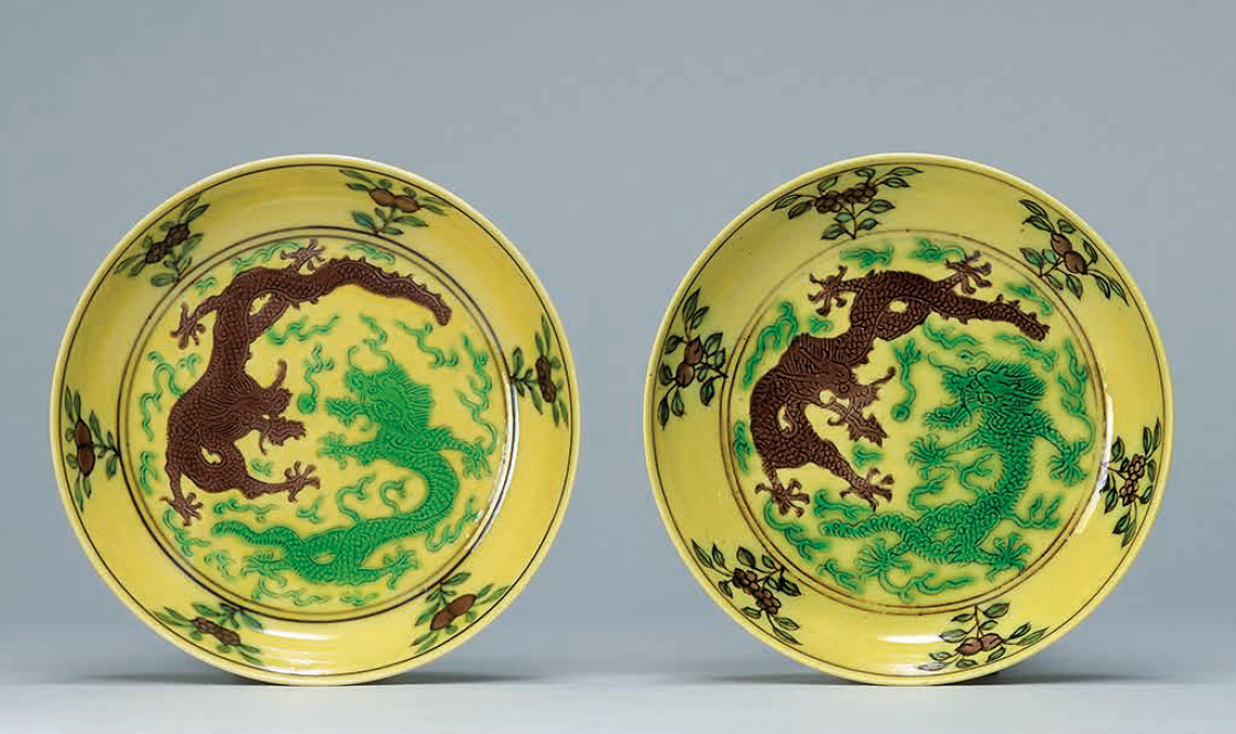 A pair of small yellow-ground green and aubergine-enameled 'Dragon' dishes, Daoguang six-character seal marks