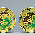 A pair of small yellow-ground green and aubergine-enameled 'Dragon' dishes, Daoguang six-character seal marks in aubergine enamels and of the period (1821-1850)