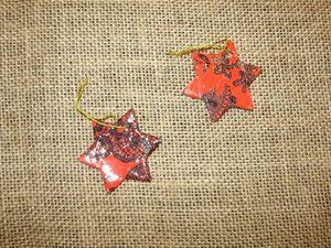 pampilles étoiles rouges et noires