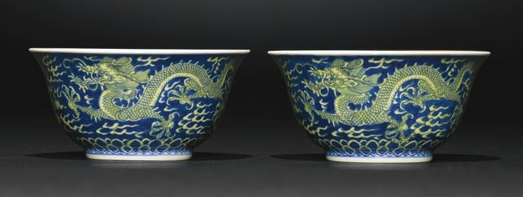 A fine pair of blue and yellow 'Dragon' bowls, Qianlong seal marks and period