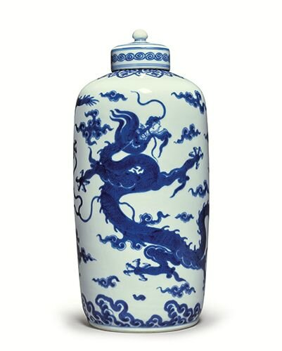 A magnificent and rare blue and white cylindrical 'Dragon' tea caddy and cover, Yongzheng mark and period (1723-1735)