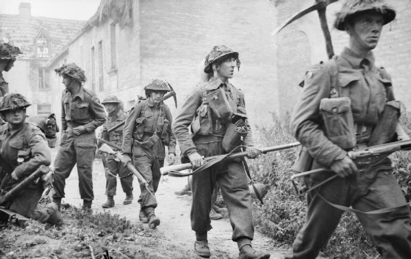 Infantry_of_6th_Royal_Scots_Fusiliers,_15th_(Scottish)_Division_in_the_village_of_St_Mauvieu-Norrey_in_Normandy,_during_Operation_'Epsom',_26_June_1944__
