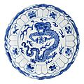 A blue and white'dragon' dish.bearing xuande six-character mark, but kangxi