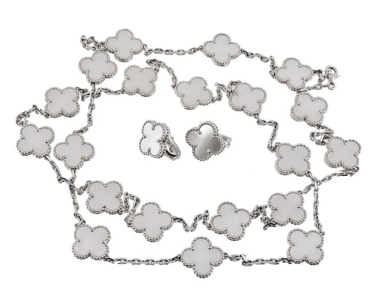 An Alhambra mother of pearl necklace and ear clips by Van Cleef