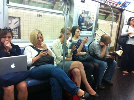 macbook-iphone-kindle-ipod-book-nyc-subway