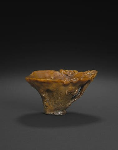 An elegantly carved rhinoceros horn libation cup, 17th-18th century