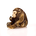An ivory netsuke of a monkey. by masamitsu, 19th century