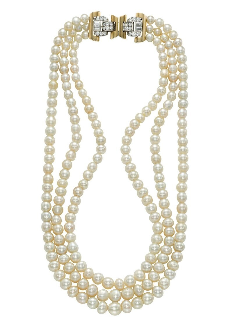A three-strand natural pearl and diamond necklace