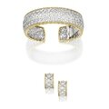 18 karat two-color gold and diamond bracelet and earclips, buccellati