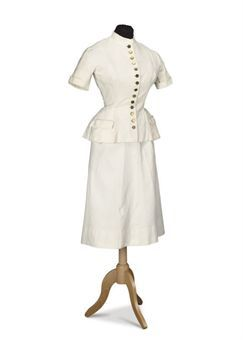A cream matelass summer suit. Cristobal Balenciaga, c. 1950. Im