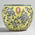 A yellow-ground grisaille-enameled fish bowl, qing dynasty, dayazhai mark, guangxu period (1875-1908)