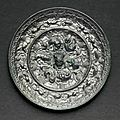 A silvery bronze circular  'Lion and grapevine' mirror, Tang dynasty (AD 618-907)