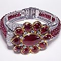 Cartier. bangle, 1937, diamonds and a double row of rubies set in platinum with a 19th century indian central motif