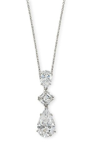An important diamond three-stone pendant
