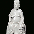 A Blanc de Chine porcelain sitting Dignitary, China, Dehua, Qing Dynasty, 18th century