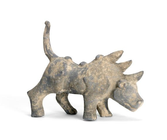 A grey pottery figure of a three-horned mythical beast, Han Dynasty