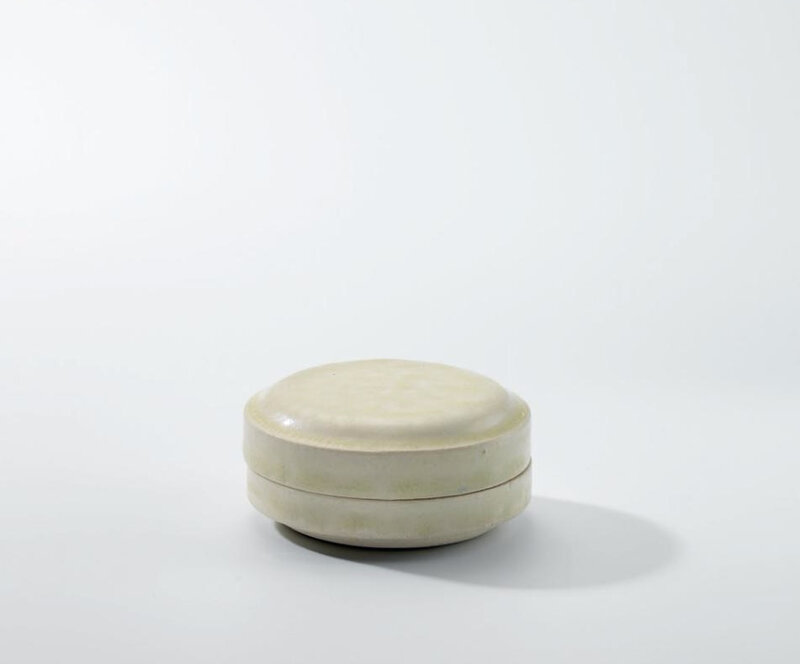 A small white-glazed circular box and cover, Tang dynasty (618-907)