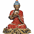 A rare jun-type glazed figure of buddha, 18th century, the european ormolu mount 19th century
