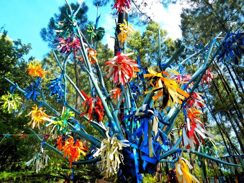 7 bouquets de tournesols multicolores sur ciel bleu