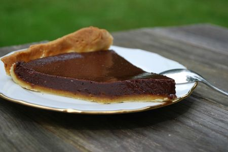 Chocolate and caramel tart's piece
