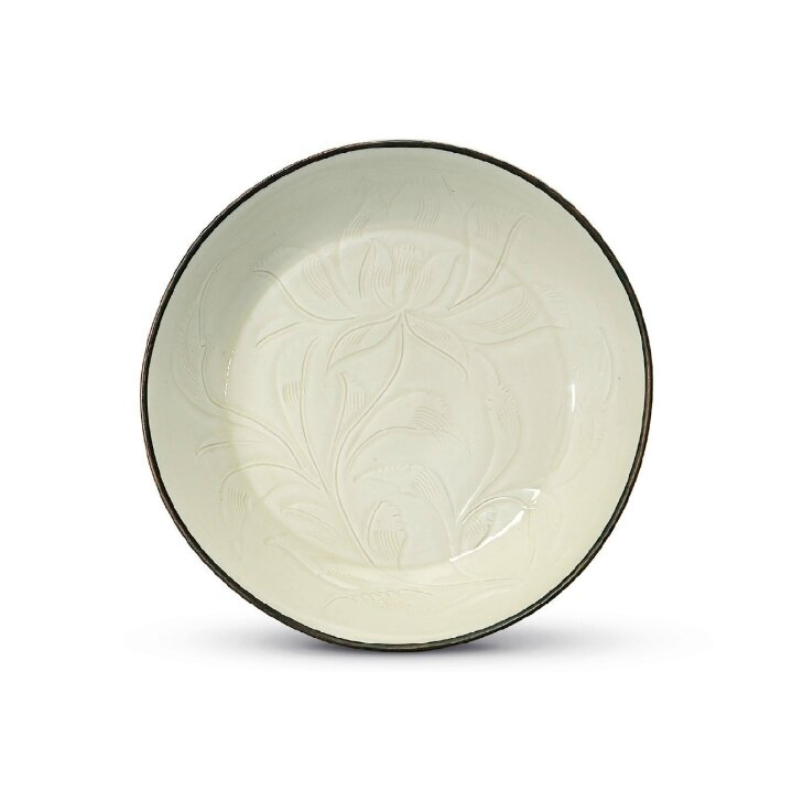 A rare and finely carved Ding 'lotus' dish, Northern Song dynasty, 11th-12th century
