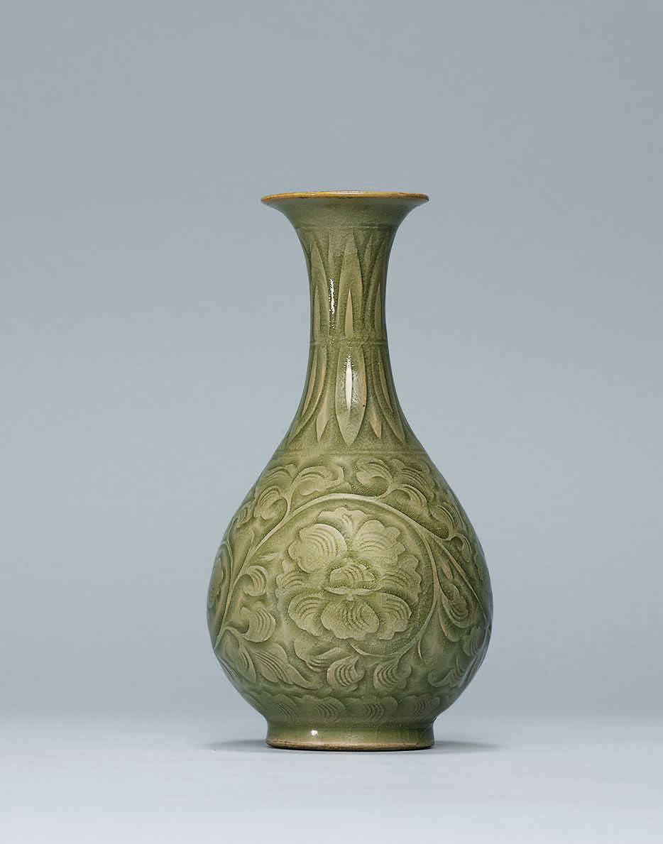 A rare carved Yaozhou pear-shaped vase, Northern Song dynasty (960-1127)