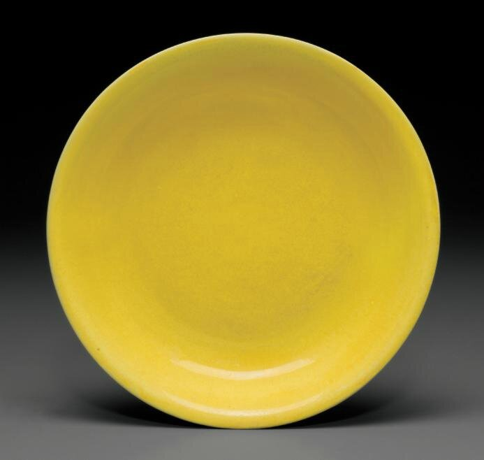 A yellow-glazed dish, Jiajing six-character mark in underglaze blue within a double circle and of the period (1522-1566)