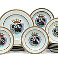A set of ten armorial soup plates and four chargers for the Dutch market, circa 1752