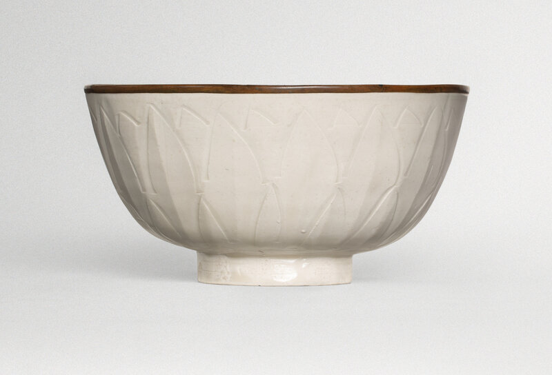 A carved 'Ding' 'fish' bowl, Northern Song dynasty (960-1127)