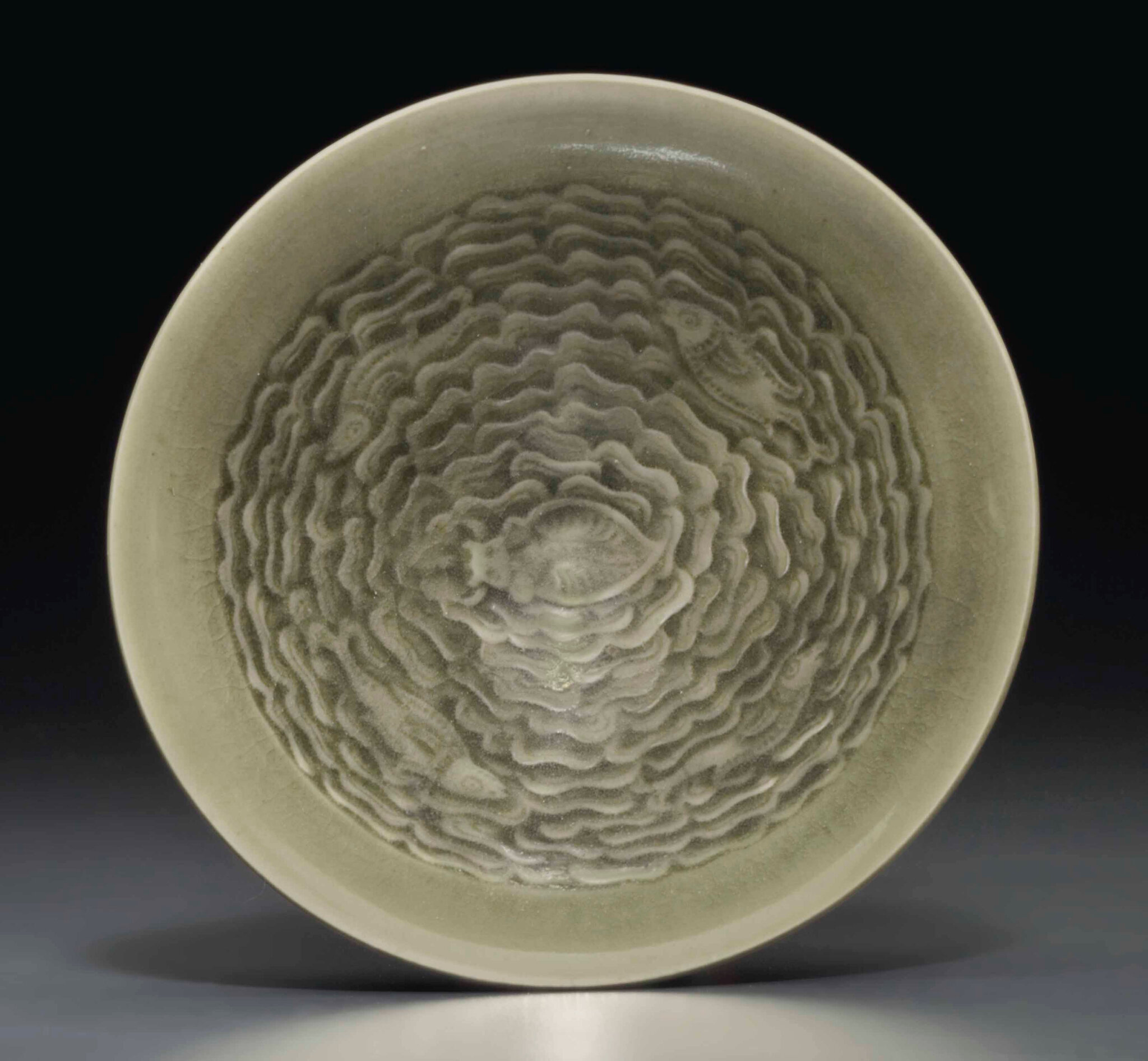 A small Yaozhou celadon molded conical bowl, Northern Song-Jin dynasty, 12th-13th century