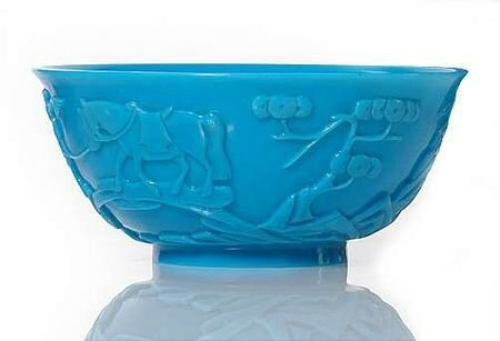 A blue-turquoise-colored Beijing glass bowl with carved buddhist scene, China, 19th century. photo courtesy Nagel