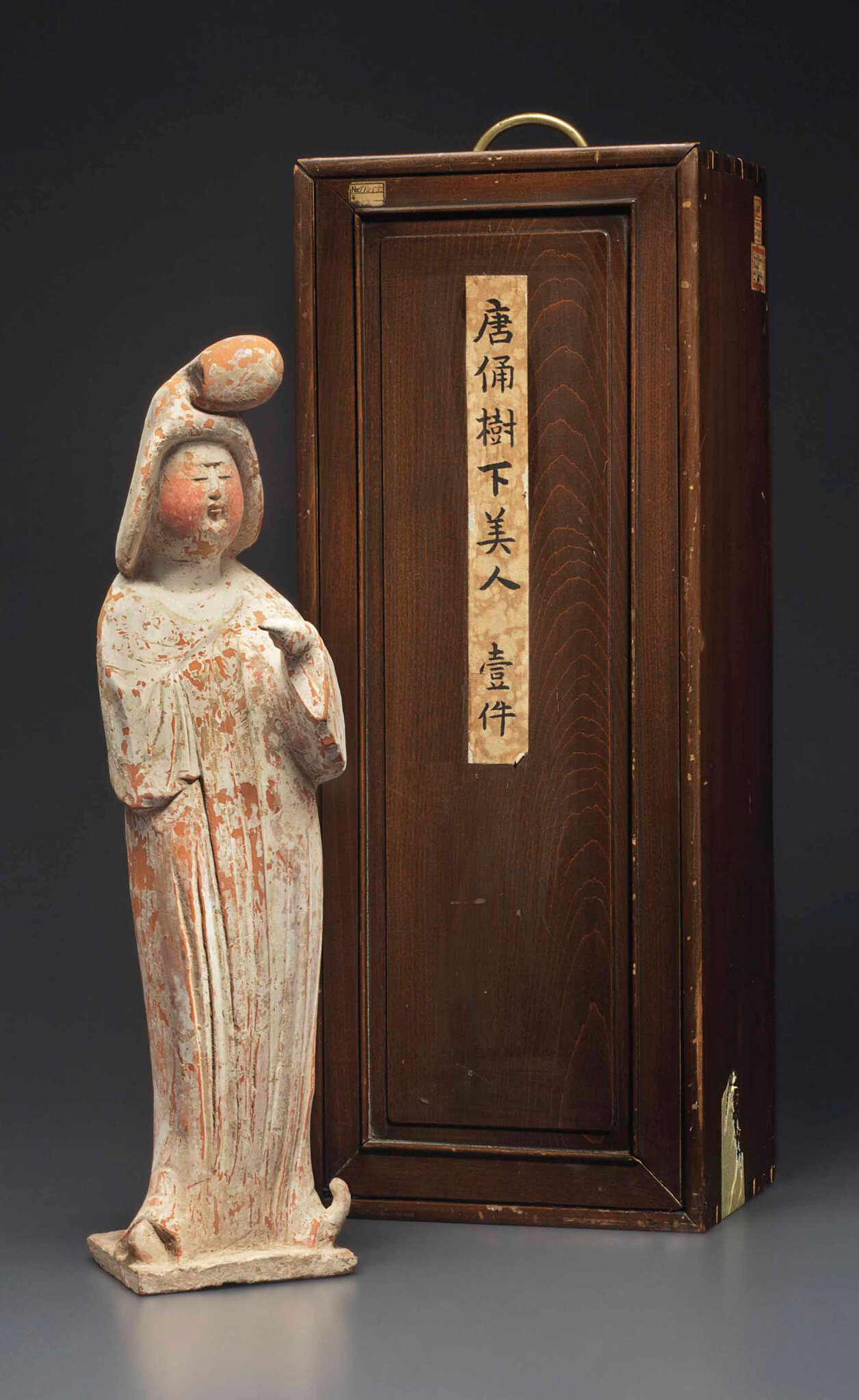 A painted red pottery figure of a standing court lady,Tang dynasty (AD 618-907)