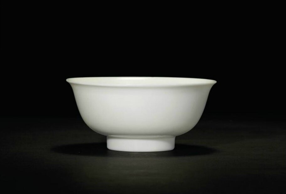 A fine and very rare anhua-decorated tianbai 'dragon' tea bowl, Yongle incised four-character seal mark and of the period (1403-1424)