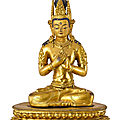 A large gilt-bronze figure of vairocana, tibet, the figure circa 1900, the stand circa 1400
