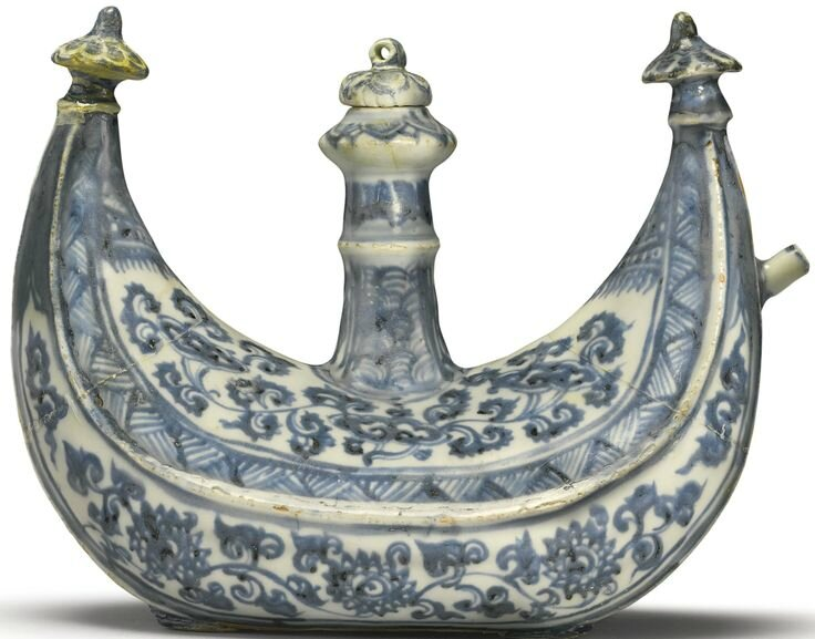 A rare blue and white crescent-shaped flask and cover, Ming dynasty, 15th-16th century