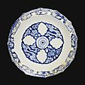 A timurid blue and white pottery dish with cloud band design, persia, 15th century