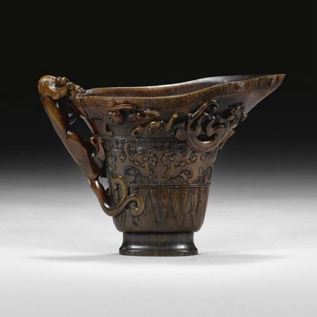 An archaistic rhinoceros horn libation cup, 17th century