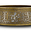 An early mamluk silver-inlaid brass bowl, egypt, 14th century