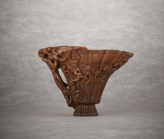 A rare and superbly carved rhinoceros horn libation cup, Late Ming-early Qing dynasty, 17th century