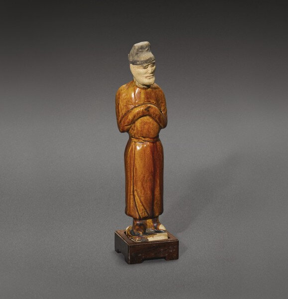 An amber-glazed figure of a standing groom, Tang dynasty (618-907)