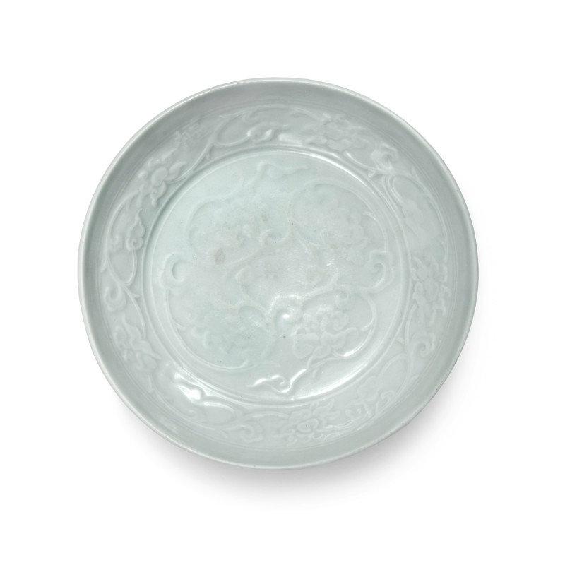 A molded 'Shufu' white-glazed 'lotus' dish, Yuan dynasty (1279-1368)