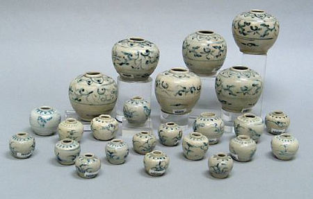 A selection of twenty-four blue and white jars and jarlets. Late